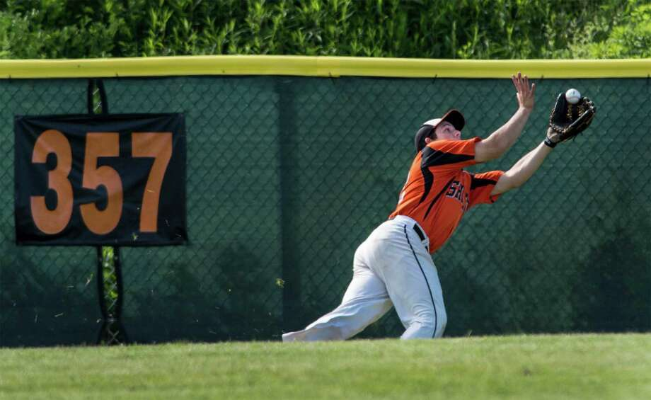 Shelton high school outfielder Paul Salley makes a dramatic diving catch during a second round game of the CIAC class LL baseball tournament against Newtown high school played at Shelton high school, Shelton, CT on Thursday, June 4th, 2015. Photo: Mark Conrad / Connecticut Post Freelance