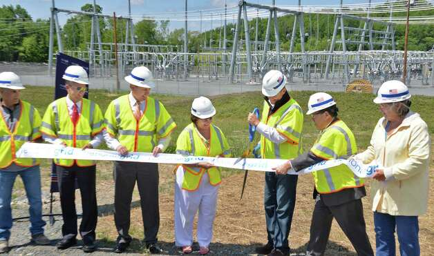 Dignitaries cut a ceremonial ribbon to officially open National Grid's Eastover electric sub station Thursday June 4, 2015 in Speigletown, NY.   (John Carl D'Annibale / Times Union) Photo: John Carl D'Annibale / 00032126A