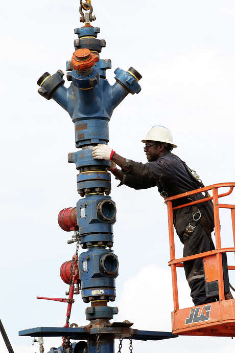 Nathen George removes a frac tree from a well on a ranch southwest of Ben Bolt. A five-year probe by the EPA documented some cases where wastewater was spilled on the surface or defective oil and gas wells may have caused problems underground with drinking water supplies, but the agency reported that those instances were relatively infrequent. Photo: Express-News File Photo / ©2013 San Antonio Express-News