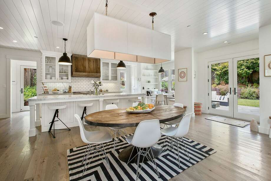 The dining area leads to the backyard through French doors. Photo: Open Homes Photography