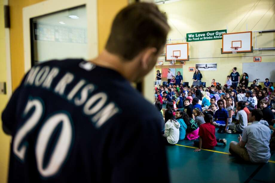 Seattle Mariners player Logan Morrison peeks out at students before presenting a D.R.E.A.M. Team assembly for kindergarten through fifth grade students, photographed Thursday, June 4, 2015, at Thorndyke Elementary School in Tukwila, Washington. The program is in its eighteenth year, and includes four Seattle-area schools.  (Jordan Stead, seattlepi.com) Photo: SEATTLEPI.COM