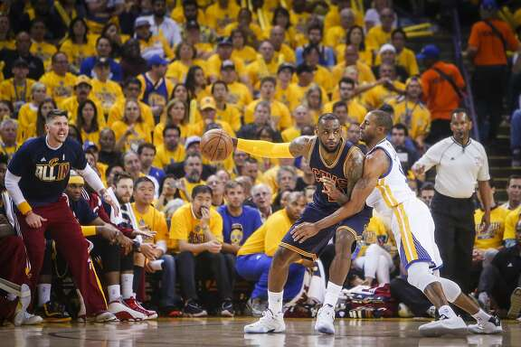 Golden State Warriors' Andre Iguodala guards Cleveland Cavaliers' LeBron James in the first period during Game 1 of The NBA Finals on Thursday, June 4, 2015 in Oakland, Calif.