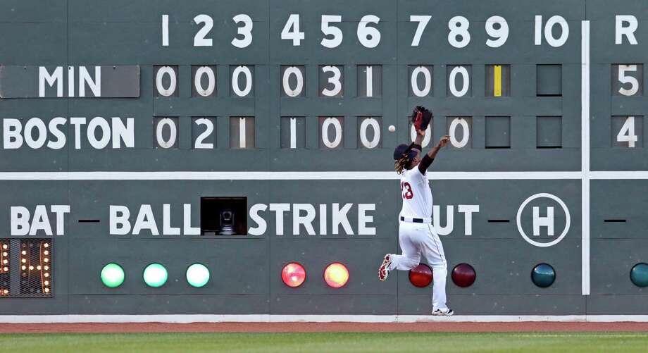 Boston Red Sox left fielder Hanley Ramirez can't make a play on an RBI double by Minnesota Twins Eduardo Escobar in the ninth inning during a baseball game, Thursday, June 4, 2015, at Fenway Park in Boston. (AP Photo/Charles Krupa) Photo: Charles Krupa, STF / AP