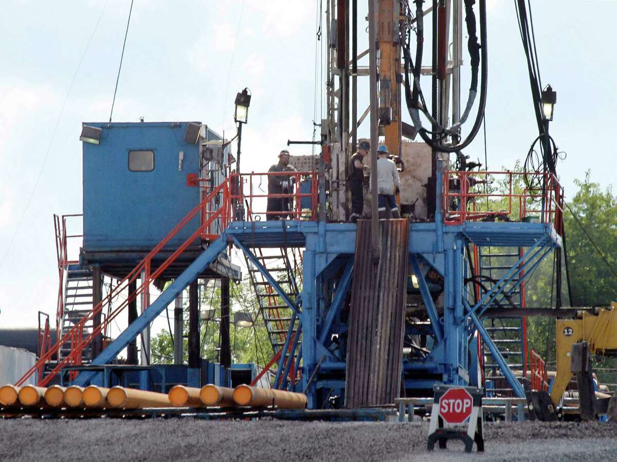 FILE - In this June 25, 2012 file photo, a crew works on a gas drilling rig at a well site for shale based natural gas in Zelienople, Pa. The oil and gas drilling method known as hydraulic fracturing, or