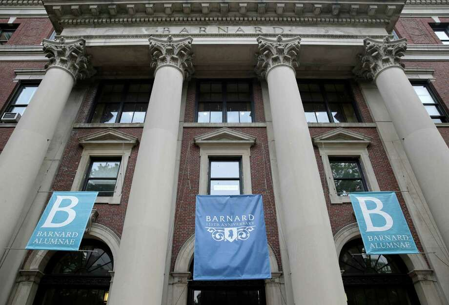 FILE - In this May 28, 2015 file photo, banners hang from a building at Barnard College in New York. A black student from nearby Columbia University claims that he was racial profiled by police at the college. Photo: Seth Wenig / AP