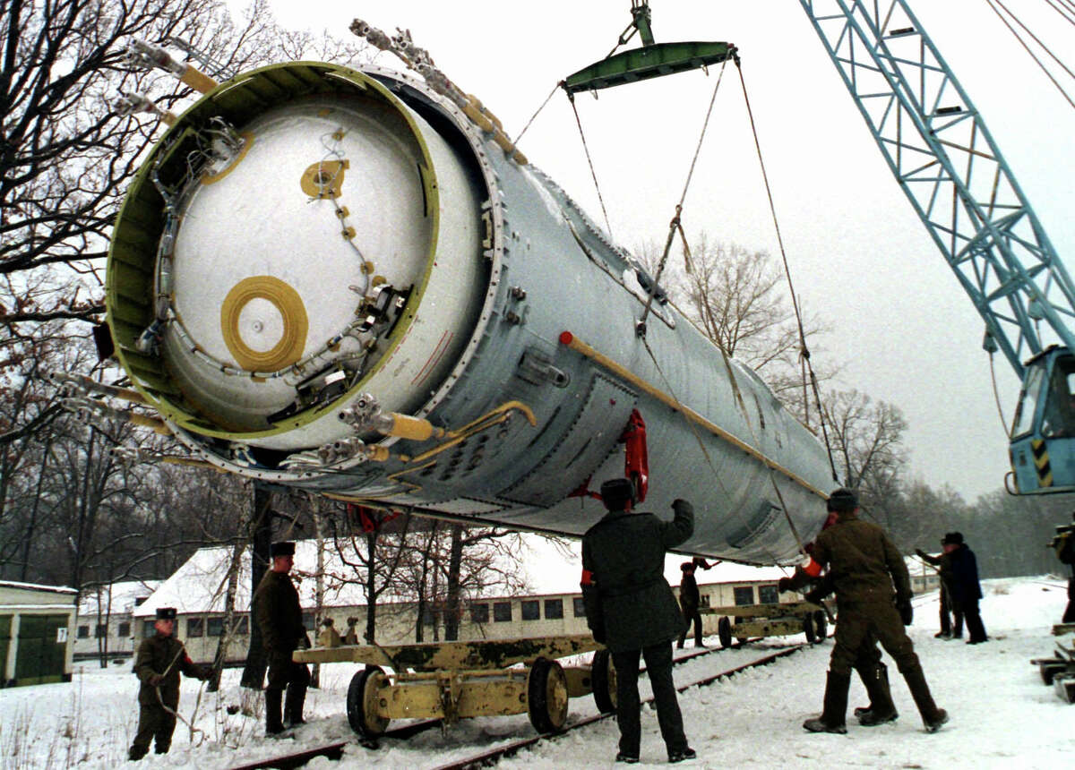"""FILE - In this Dec. 24, 1997 file photo, soldiers prepare to destroy a ballistic SS-19 missile in the yard of the largest former Soviet military rocket base in Vakulenchuk, Ukraine. The Obama administration is weighing a range of aggressive responses to Russia?'s alleged violation of a Cold War-era nuclear missile treaty, including deploying land-based missiles in Europe that could pre-emptively destroy the Russian weapons. This ?""""counterforce?"""" option is among possibilities the administration is discussing as it reviews its entire policy toward Russia in light of Moscow?'s military intervention in Ukraine, its annexation of Crimea and other confrontational actions in Europe and beyond. The options go so far as one implied -- but not stated explicitly -- that would improve the ability of U.S. nuclear weapons to destroy military targets on Russian territory. (AP Photo, File) ORG XMIT: WX106"""