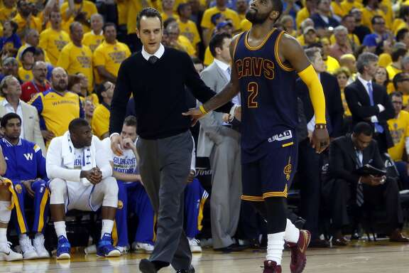 Cleveland Cavaliers' Kyrie Irving heads to the locker room in overtime of 108-100 loss to Golden State Warriors in Game 1 of the 2015 NBA Finals at Oracle Arena in Oakland, Calif., on Thursday, June 4, 2015.