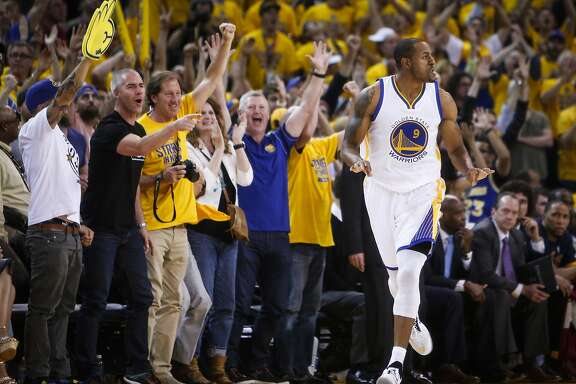 The crowd cheers on Golden State Warriors' Andre Iguodala in the fourth period during Game 1 of The NBA Finals on Thursday, June 4, 2015 in Oakland, Calif.