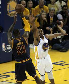Andre Iguodala guards Lebron James during the 3rd quarter of Game 1 of the NBA Finals on Thursday, June 4, 2015 in Oakland, Calif.