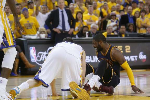 Cleveland Cavaliers' Kyrie Irving injures himself in overtime of 108-100 loss to Golden State Warriors in Game 1 of the 2015 NBA Finals at Oracle Arena in Oakland, Calif., on Thursday, June 4, 2015.