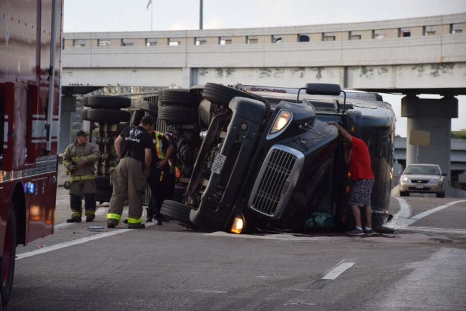An 18-wheeler hauling watermelons flipped over Friday, June 5, 2015 near downtown. Photo: By Mark D. Wilson/San Antonio Express-News