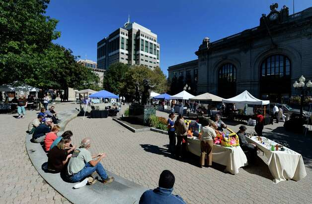 A lunchtime crowd enjoys the beautiful weather Wednesday, Sept. 25, 2013, during the September in the City Art Fair in Tricentennial Park in Albany, N.Y. The event, which occurs every Wednesday in September from 11:30 a.m. to 2:00 p.m., is sponsored by Albany Center Gallery and Exit 97.7. (Skip Dickstein / Times Union) Photo: Skip Dickstein, ALBANY TIMES UNION