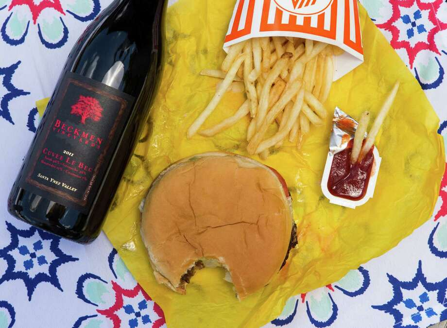What a combo!: A  Whataburger can be perfectly paired with a hoppy amber ale or a big and bold Bordeaux. Photo: William Luther /San Antonio Express-News / © 2015 San Antonio Express-News