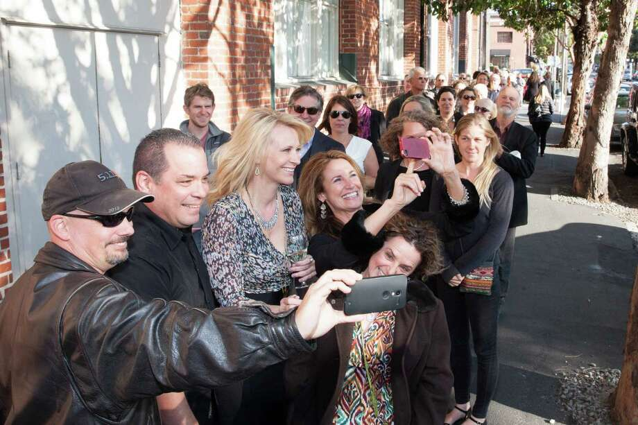 """Leslie Sbrocco, host of """"Check, Please! Bay Area"""" takes photos with fans at the show's 10th anniversary party on June 2, 2015. Photo: Drew Altizer, Drew Altizer Photography / © 2015 Drew Altizer Photography"""