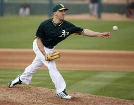 Oakland Athletics' Pat Venditte against San Francisco Giants in 4th inning in Cactus League opener at Hohokam Stadium in Mesa, Arizona, on Tuesday, March 3, 2015.