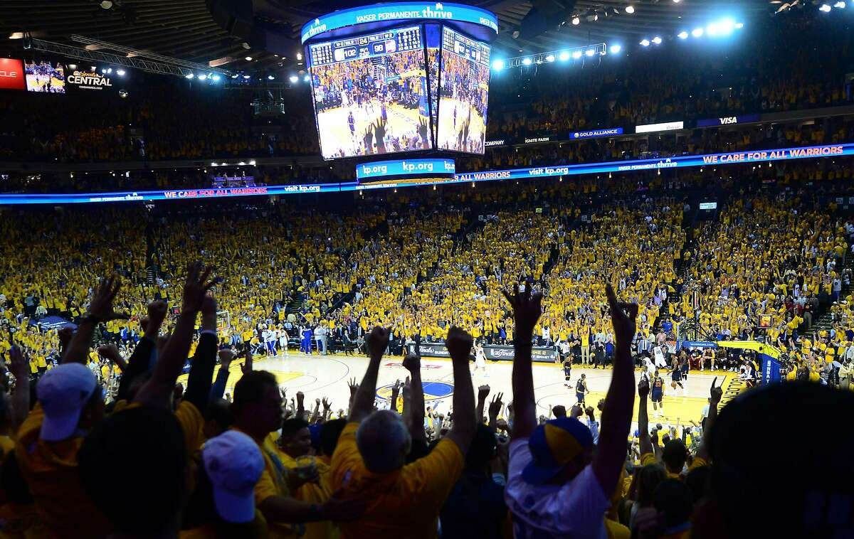 TOPSHOTS Golden State Warriors fans celebrate victory over the Cleveland Cavaliers in Game 1 of the 2015 NBA Finals in Oakland, California, on June 4, 2015. The Warriors defeated the Cavaliers 108-100 in overtime. AFP PHOTO / FREDERIC J. BROWNFREDERIC J. BROWN/AFP/Getty Images