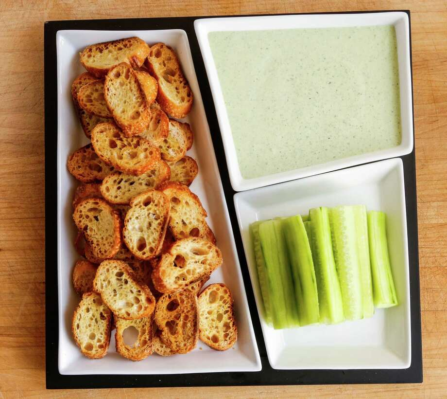 Creamy watercress dip with cucumber spears and crostini (aka deconstructed watercress tea sandwiches). Photo: Russell Yip /The Chronicle / ONLINE_YES