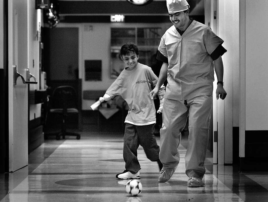 Saleh's recovery went better than anyone had expected, and through it all he never lost the spirit that had earned him the name Lion Heart. One night at Children's Hospital, he and a custodian, Khaled Abdorabihe, played soccer in the hallway until a nurse caught them and sent Saleh back to bed. Photo: Deanne Fitzmaurice, The Chronicle