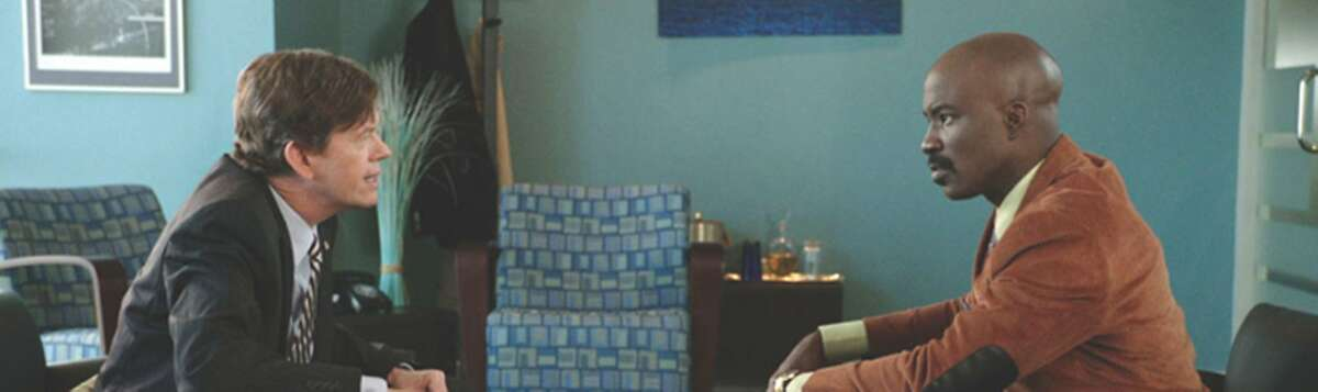 Dylan Baker and Mike Colter in a scene from