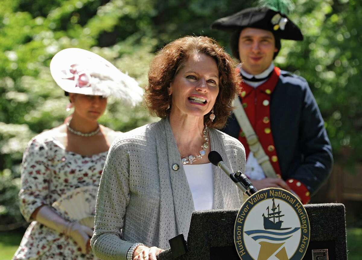 New York State Assemblymember Patricia Fahy speaks during a press conference announcing seven National Heritage Area Heritage Development Grants to historical and cultural institutions in the upper Hudson Valley at the Ten Broeck Mansion gardens on Friday, June 5, 2015 in Albany, N.Y. Standing in the background are living history reenactors Lisa Nunez and Chad Johnson of New Windsor Cantonment State Historic Site. (Lori Van Buren / Times Union)