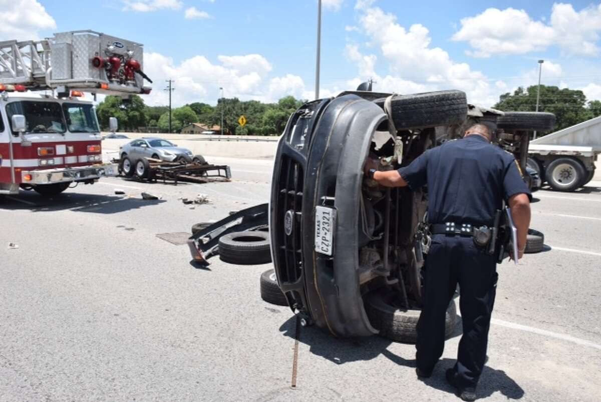 Traffic backed up for miles on Loop 410 after the driver of a vehicle left an overturned pickup and trailer littered on the highway after losing control on the Northeast Side after around 1:45 p.m.