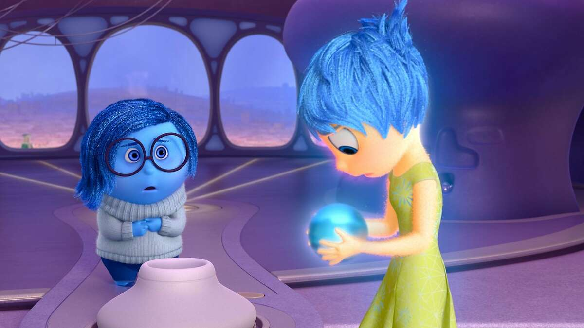"""In the Disney-Pixar summer release """"Inside Out,"""" about the voices inside an 11-year-old girl's head, little blue Sadness is voiced by Phyllis Smith (""""The Office"""") and the much brighter Joy is voiced by Amy Poehler (""""Parks and Recreation""""). The movie opens Friday, June 19. Pictured (L-R): Sadness, Joy. ©2015 Disney•Pixar. All Rights Reserved."""