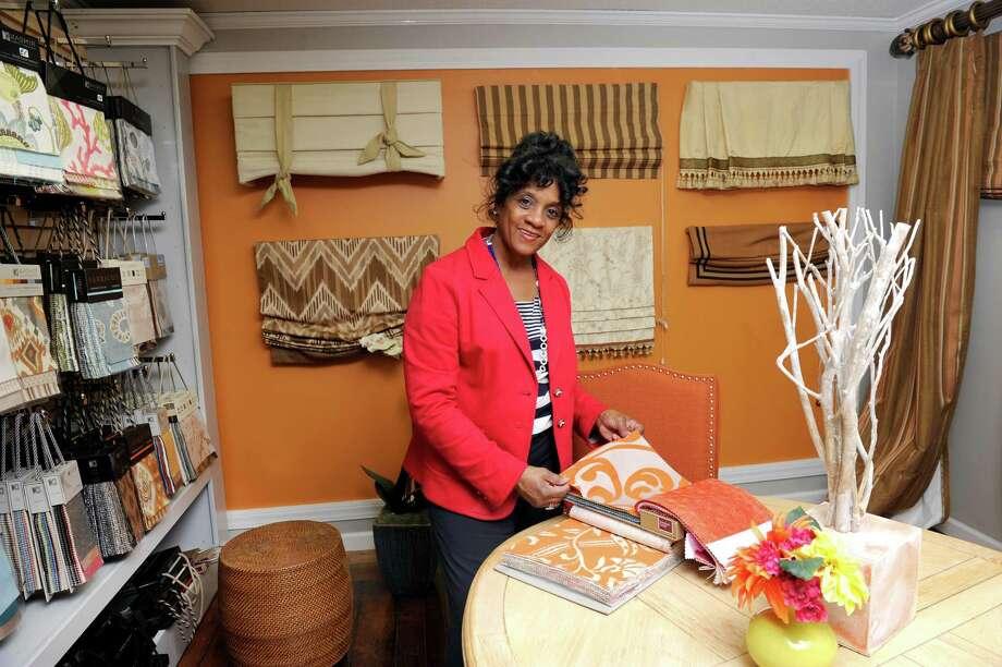 Shauna Barker is the owner of EvVoke Window Salon in Danbury, Conn. Photo Friday, June 5, 2015. Photo: Carol Kaliff / The News-Times