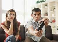 Woman watching boyfriend play video games