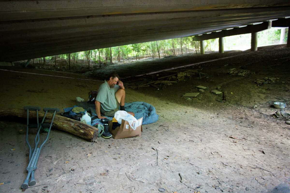 Paul Carbonneau, 60, was able to escaped from a food by keeping himself up an embankment until it became clear that he would have to abandon the under bridge he has called home for the past 15 years to survive the flood. Thursday, June 4, 2015, in Houston. ( Marie D. De Jesus / Houston Chronicle )