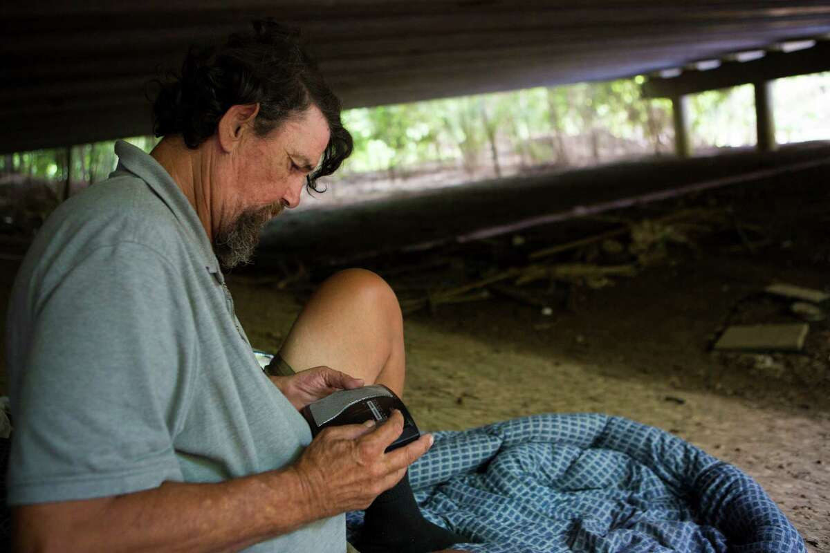 Paul Carbonneau, 60, a homeless man from Houston, was able to save his radio from a flood, but lost his mattress and the few things he owned, including his stove. Thursday, June 4, 2015, in Houston. ( Marie D. De Jesus / Houston Chronicle )