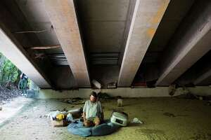 Paul Carbonneau, 60, a homeless man who has been living under a bridge the past 15 years, lost the few belongings he had from the flood that overwhelmed Houston last week. Carbonneau who has mobility difficulties grabbed his crutches and walked up an embankment to the main road to save his life. Thursday, June 4, 2015, in Houston. ( Marie D. De Jesus / Houston Chronicle )