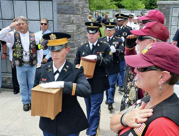 US Army National Guard Lt. Alix Walls, left, leads a military honor guard carrying the remains of 8 unclaimed veterans during an Interment Ceremony at the Saratoga National Cemetery Friday June 5, 2015 in Schuylerville, NY.  (John Carl D'Annibale / Times Union) Photo: John Carl D'Annibale / 00032127A