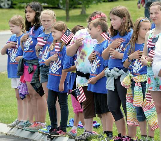 Students from Schuylerville Elementary School attend an Interment Ceremony for the remains of 8 unclaimed veterans at the Saratoga National Cemetery Friday June 5, 2015 in Schuylerville, NY.  (John Carl D'Annibale / Times Union) Photo: John Carl D'Annibale / 00032127A