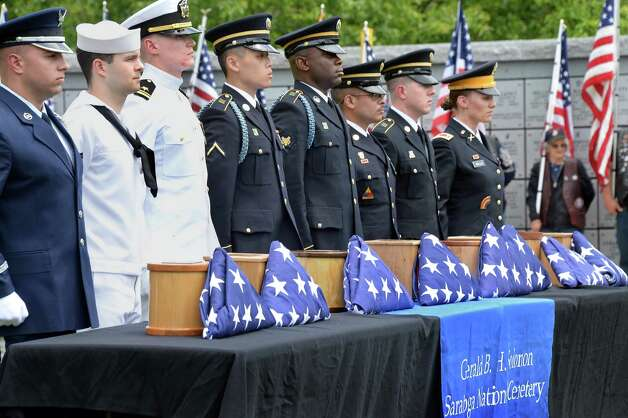 A military honor guard with the remains of 8 unclaimed veterans during an Interment Ceremony at the Saratoga National Cemetery Friday June 5, 2015 in Schuylerville, NY.  (John Carl D'Annibale / Times Union) Photo: John Carl D'Annibale / 00032127A