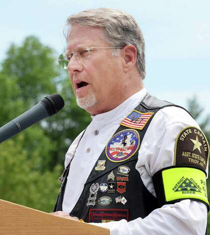Patriot Guard Riders Assistant State Captain Bill Schaaf speaks during an Interment Ceremony for the remains of 8 unclaimed veterans at the Saratoga National Cemetery Friday June 5, 2015 in Schuylerville, NY.  (John Carl D'Annibale / Times Union) Photo: John Carl D'Annibale / 00032127A