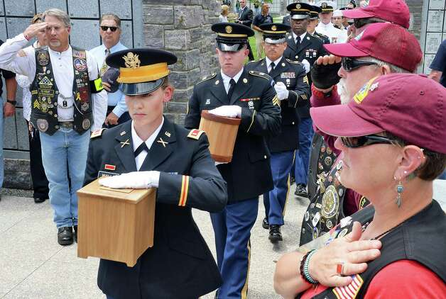 US Army National Guard Lt. Alix Walls, left, leads a military honor guard carrying the remains of 8 unclaimed veterans during an Interment Ceremony at the Saratoga National Cemetery Friday June 5, 2015 in Schuylerville, NY.  (John Carl D'Annibale / Times Union) ORG XMIT: MER2015060515010749 Photo: John Carl D'Annibale / 00032127A