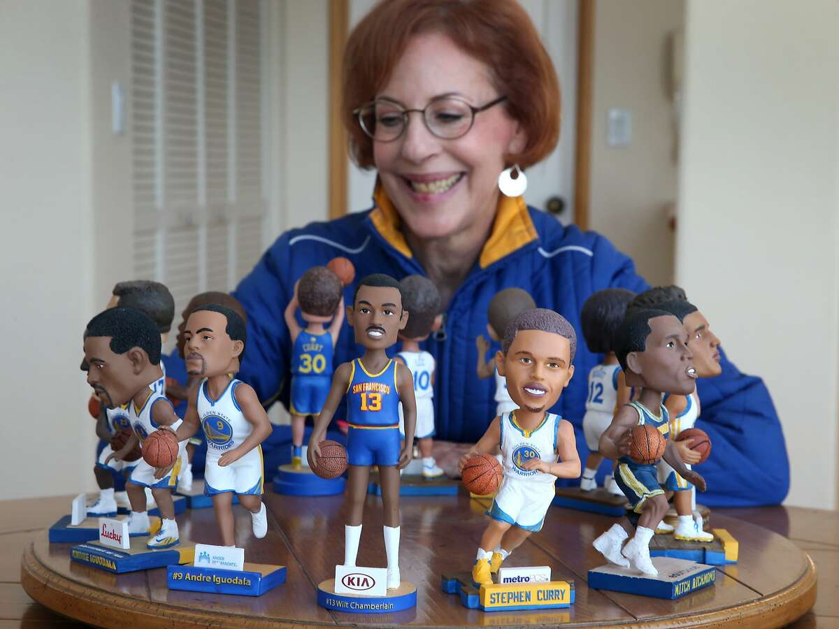 Lifelong Warriors fan Leslie Sosnick views the 14 bobbleheads she's amassed over the years at her home in Oakland, Calif. on Friday, June 5, 2015. Sosnick attended her first Warriors game when the team played at the San Francisco Civic Auditorium on her ninth birthday in 1963 and has been hooked ever since. She is currently number two on the Warrior's season ticket holder priority list.