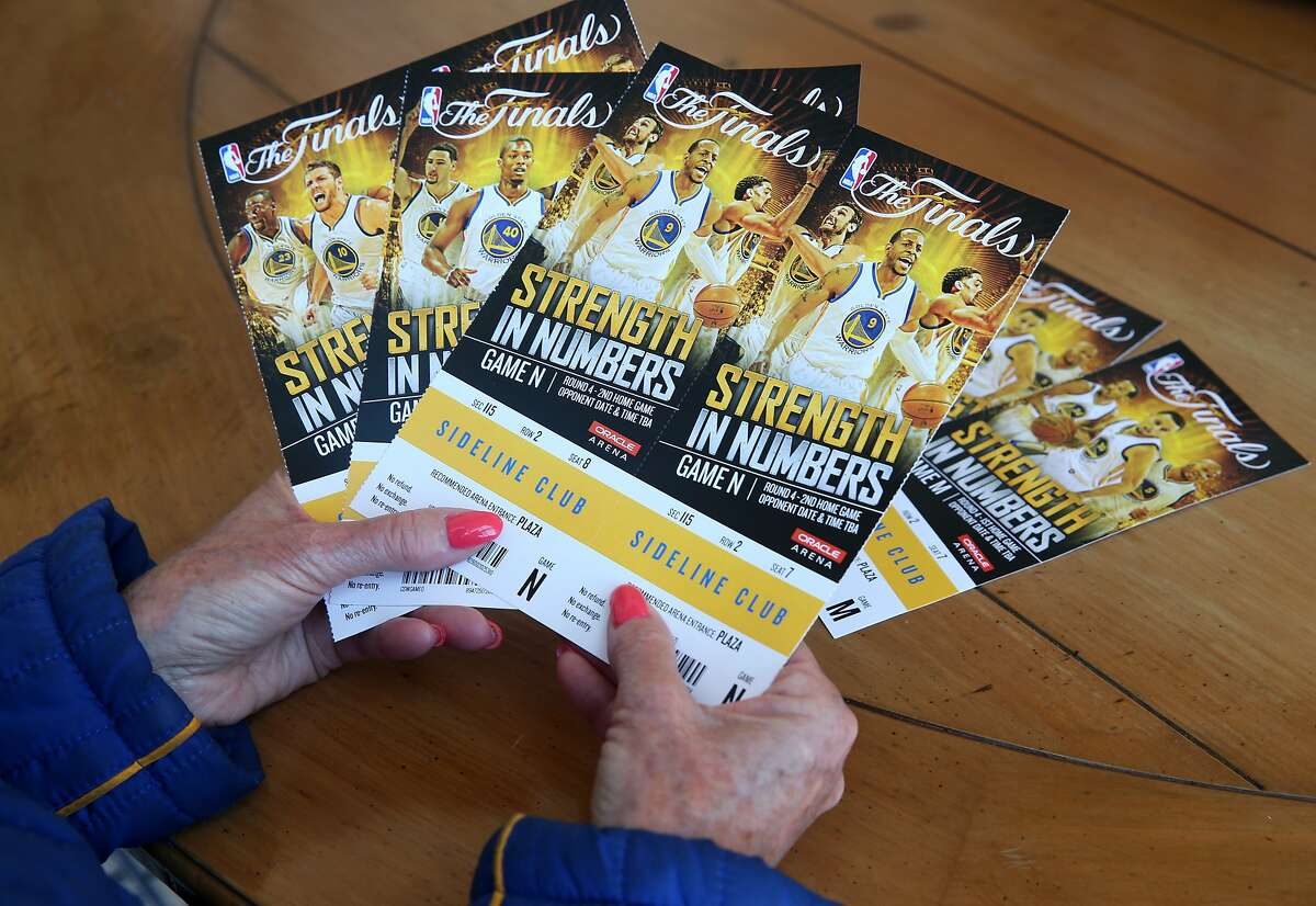 Lifelong Warriors fan Leslie Sosnick organizes her tickets to the NBA Finals games against the Cleveland Cavaliers at her home in Oakland, Calif. on Friday, June 5, 2015. Sosnick attended her first Warriors game when the team played at the San Francisco Civic Auditorium on her ninth birthday in 1963 and has been hooked ever since. She is currently number two on the Warrior's season ticket holder priority list.