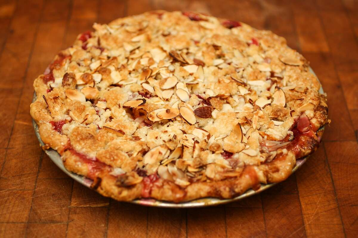 A peach raspberry pie with almond streusel topping is seen in Amy Machnak's San Francisco home Friday, June 5, 2015.