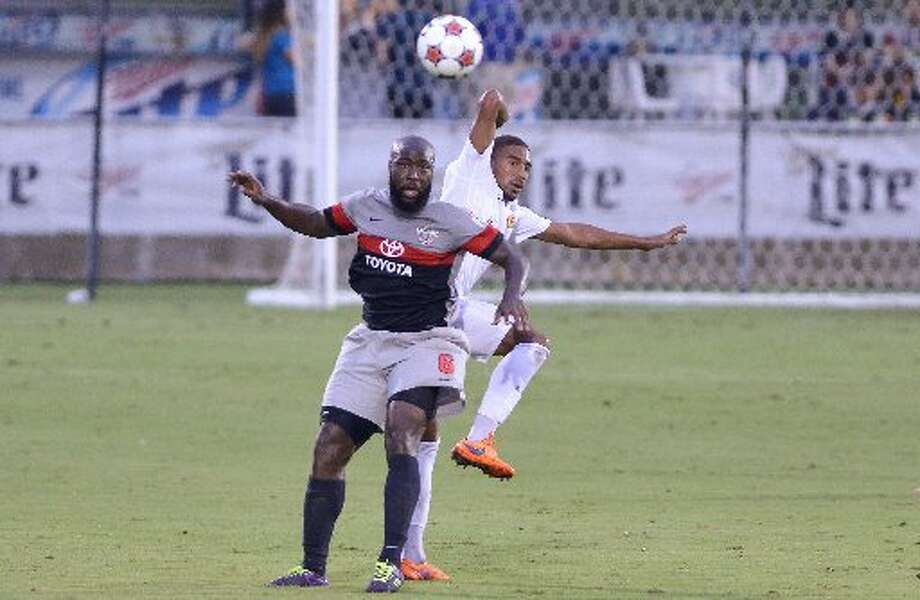 Scorpions Nana Attakora and Ft. Lauderdale's Ivan Guerrero battle for the ball during their North American Soccer League match Saturday at Toyota Field. Photo: /Robin Jerstad