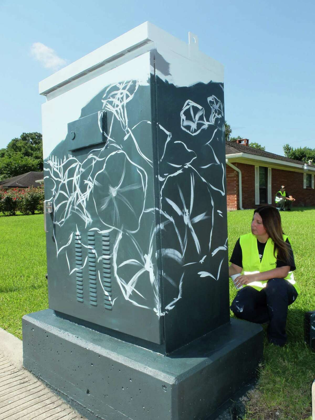 Artist Anat Ronen began painting the 8x4-foot traffic signal control cabinet at the corner of West Bellfort and Willowbend Streets with a morning glory design Thursday morning. By the day's end she had finished the first of 31 planned