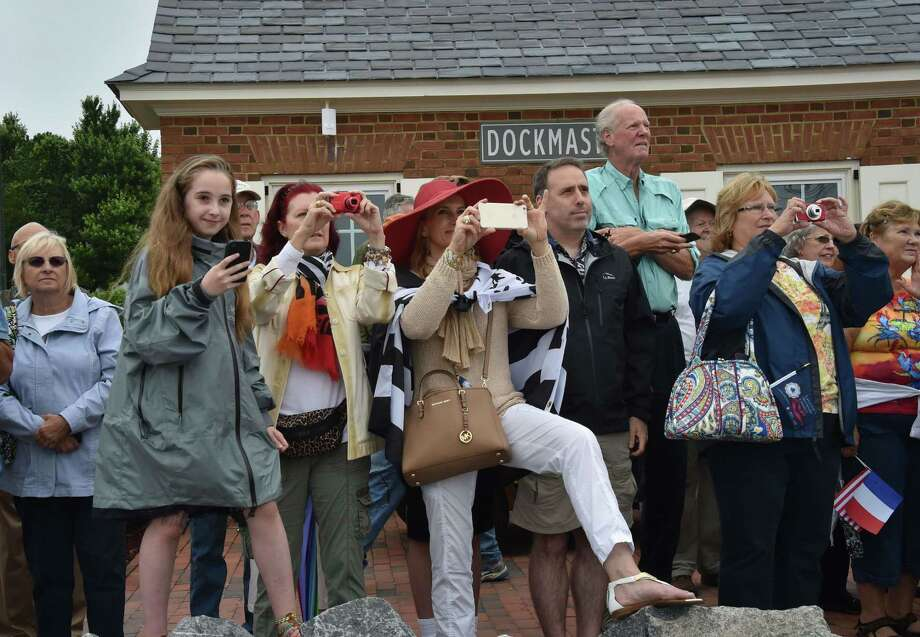 People wait for arrival of the replica of the French frigate Hermione as it sails in the Yorktown City Harbour, Virginia, on June 5, 2015. The replica of the French navy frigate Hermione which brought General Lafayette to America to rally rebels fighting Britain in the US war of independence, arrived in the United States again, 235 years after the original crossing.  Photo: MLADEN ANTONOV, AFP / Getty Images / AFP