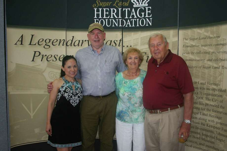 The winning team in the history scavenger hunt included, from left, Raquel Espinosa, Chuck Kelly, Barbara Batten, and Bill Little.  They were able to find all 28 of the sites alluded to in the clues, and take pictures of them. Photo: Joan Vogan / For The Chronicle