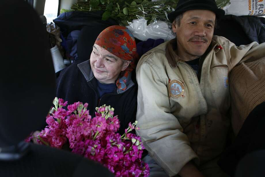 After buying flowers at the market, Margaret Karssli and Romeo DeHasa head to Paul's Flower Stand on Powell Street in San Francisco, Calif. Photo: Mike Kepka, The Chronicle