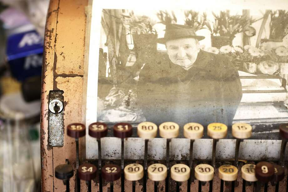 A photograph of Harvey Nalbandian rests in memorial on an antique cash register at Paul's Flower Stand in San Francisco, Calif. Photo: Mike Kepka, The Chronicle