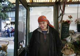 Margaret Karssli watches city life from Paul's Flower Stand on Powell Street in San Francisco, Calif.