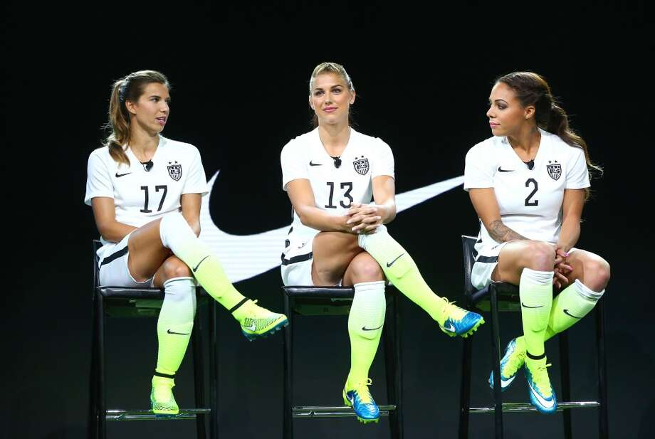 Tobin Heath (17), Alex Morgan (13) and Sydney Leroux (2) of the USWNT unveil the United States' new World Cup soccer uniforms April 22, 2015, at Quixote in West Hollywood, California. Photo: Victor Decolongon, Getty Images
