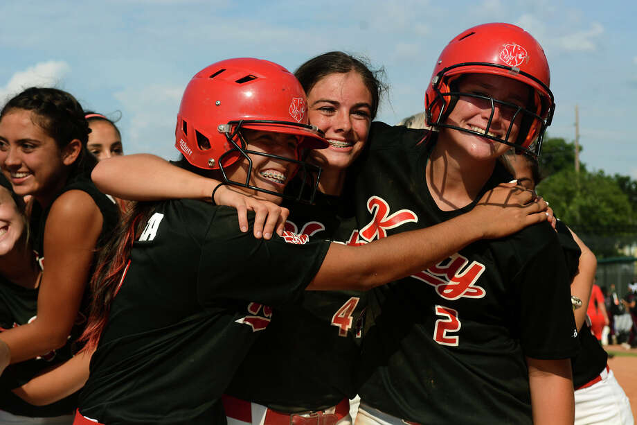 The Katy trio of freshman 3rd baseman Kayla Garcia, junior centerfielder Katie Clark, and sophomore pitcher Kourtney Coveney celebrate after the Tiger's 3-2 win over The Woodlands in their Class 6A UIL State Softball Championship semi-final matchup at McCombs Field in Austin on Friday, June 5, 2015. (Photo by Jerry Baker/Freelance) Photo: Jerry Baker, For The Chronicle