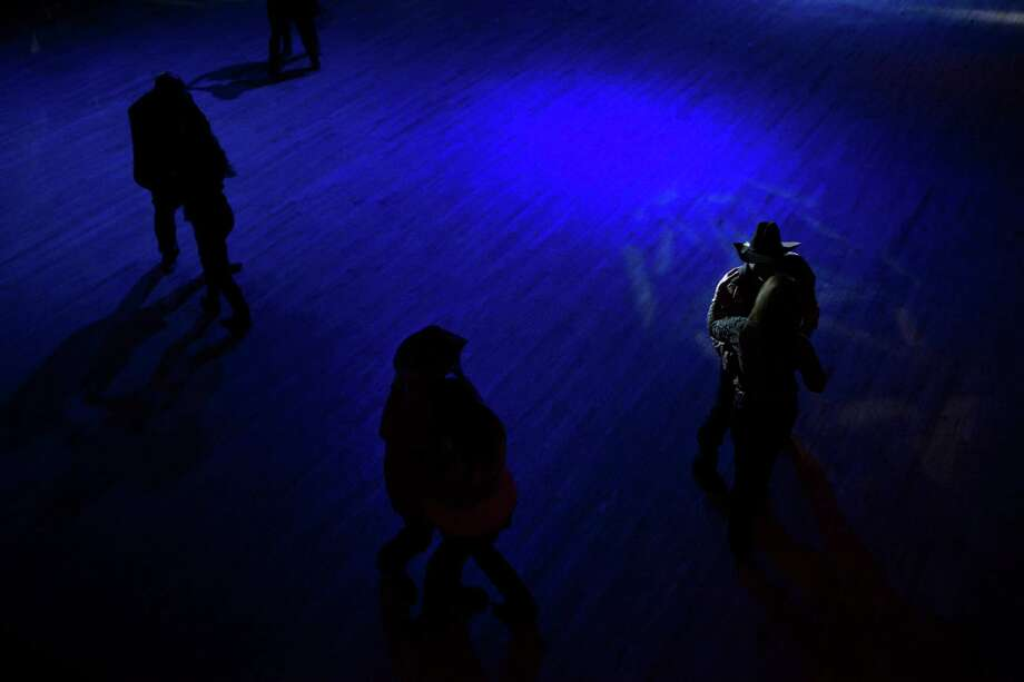 Several people dance to a live country music performance by the Sunset Riders at the Cowboy Dance Hall in San Antonio, TX on Friday, January 30, 2015 after the Cowboy Breakfast. Photo: Carolyn Van Houten / San Antonio Express-News / San Antonio Express-News