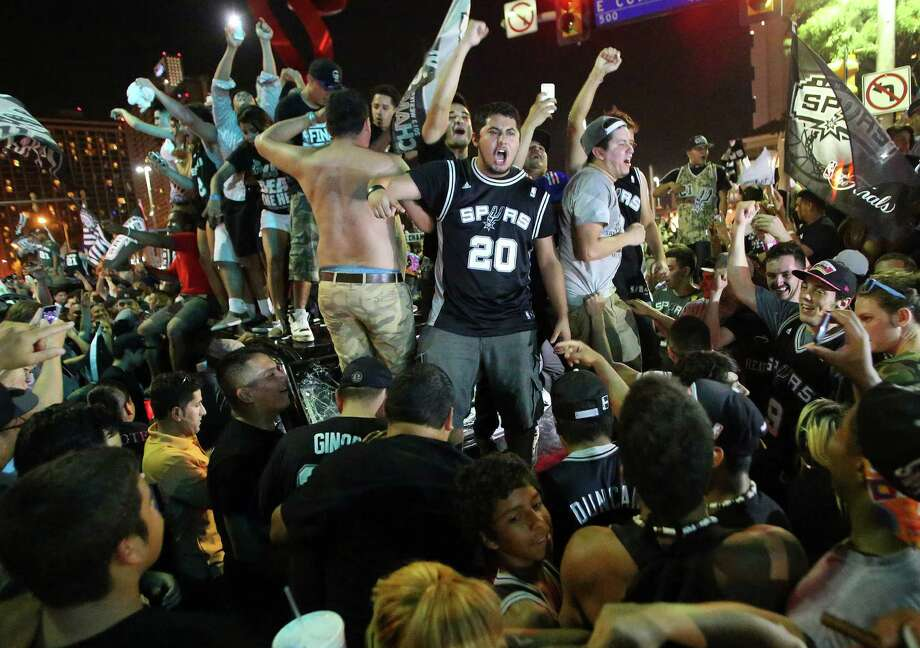 Fans celebrate in downtown San Antonio after the Spurs won NBA Championship in 2014. Celebrations like this come with the territory when living downtown. Photo: Express-News File Photo / © 2014 San Antonio Express-News